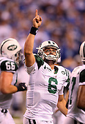 New York Jets Mark Sanchez (6) points to the sky after throwing a touchdown pass to Jets tight end Dustin Keller (81) that gives the Jets a 14-6 second quarter lead during the AFC Championship football game against the Indianapolis Colts, January 24, 2010 in Indianapolis, Indiana. The Colts won the game 30-17. ©Paul Anthony Spinelli