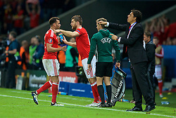 LILLE, FRANCE - Friday, July 1, 2016: Wales' Hal Robson-Kanu hugs Sam Vokes as he leaves the field following his substitution during the UEFA Euro 2016 Championship Quarter-Final match against Belgium at the Stade Pierre Mauroy. (Pic by Paul Greenwood/Propaganda)