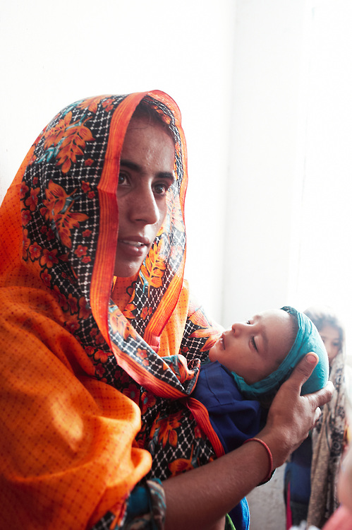 Fauzia Khan with her nephew Tagiya Babar at the government helath clinic in Mitho Barbar, Dadu, Thatta, Sindh, Pakistan on July 4, 2011.