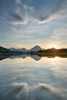 Sunset clouds reflected in still waters of the Snake River at Oxbow Bend, Grand Teton National Park Wyoming