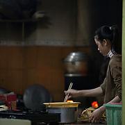 Cooking breakfast in Hue, Vietnam.