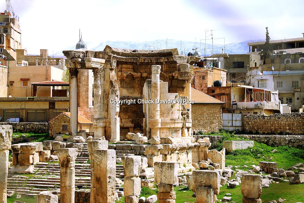 The ruins of an ancient Roman temple rise among the urban backdrop f Baalbek, Lebanon.