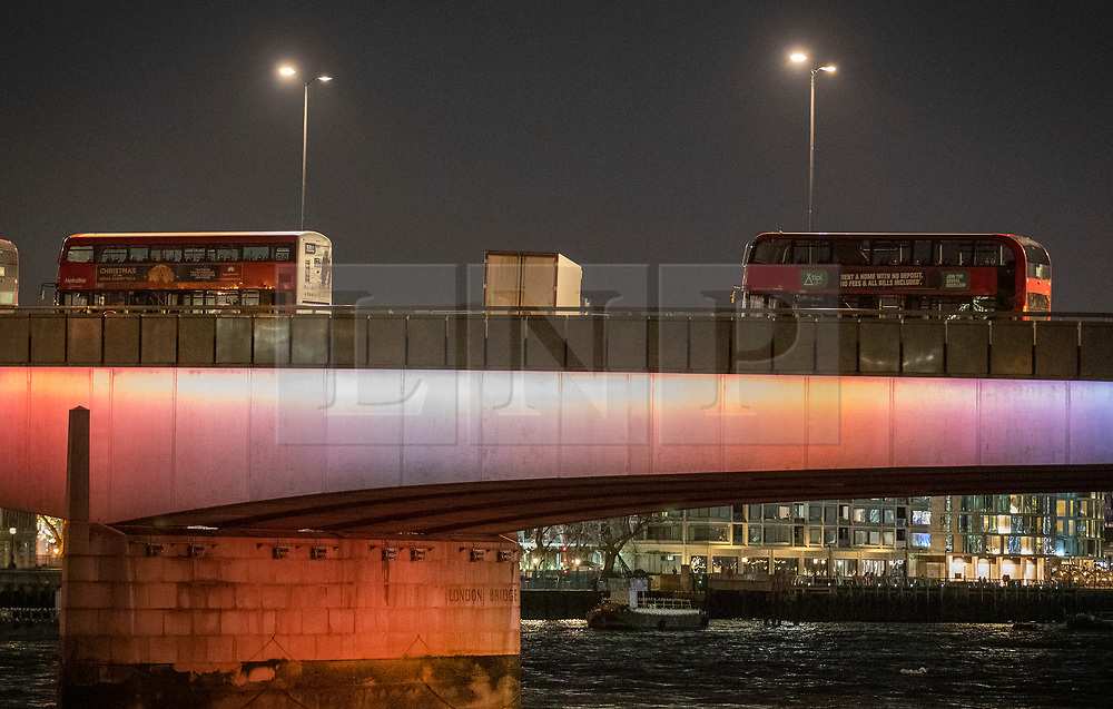© Licensed to London News Pictures. 29/11/2019. London, UK. Abandoned buses surround a truck stopped at right angles to the flow of traffic on London Bridge after the earlier incident. A number of people have been stabbed. Police have shot a suspect. Photo credit: Peter Macdiarmid/LNP