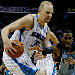 April 15, 2012; New Orleans, LA, USA; New Orleans Hornets center Chris Kaman (35) steals the ball away from Memphis Grizzlies point guard Mike Conley (11) during the second half of a game at the New Orleans Arena. The Hornets defeated the Grizzlies 88-75.  Mandatory Credit: Derick E. Hingle-US PRESSWIRE