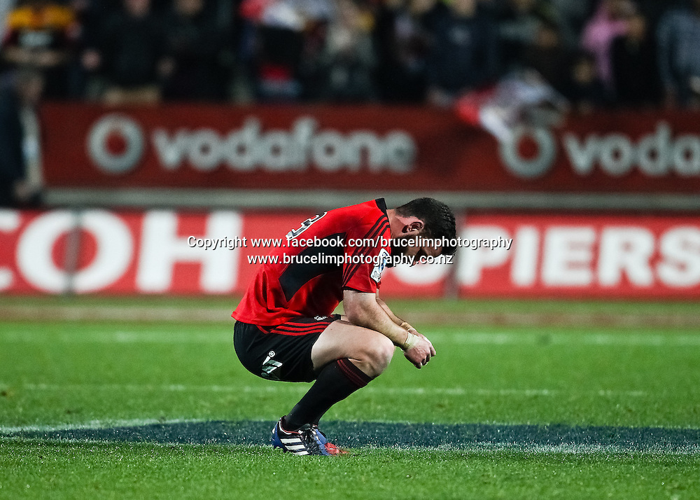 Crusaders' Ryan Crotty sits dejected after the Chiefs win the Super 15 rugby union semi final match, Chiefs v Crusaders at Waikato Stadium, Hamilton on Saturday 27 July 2013.  Photo:  Bruce Lim / Photosport.co.nz