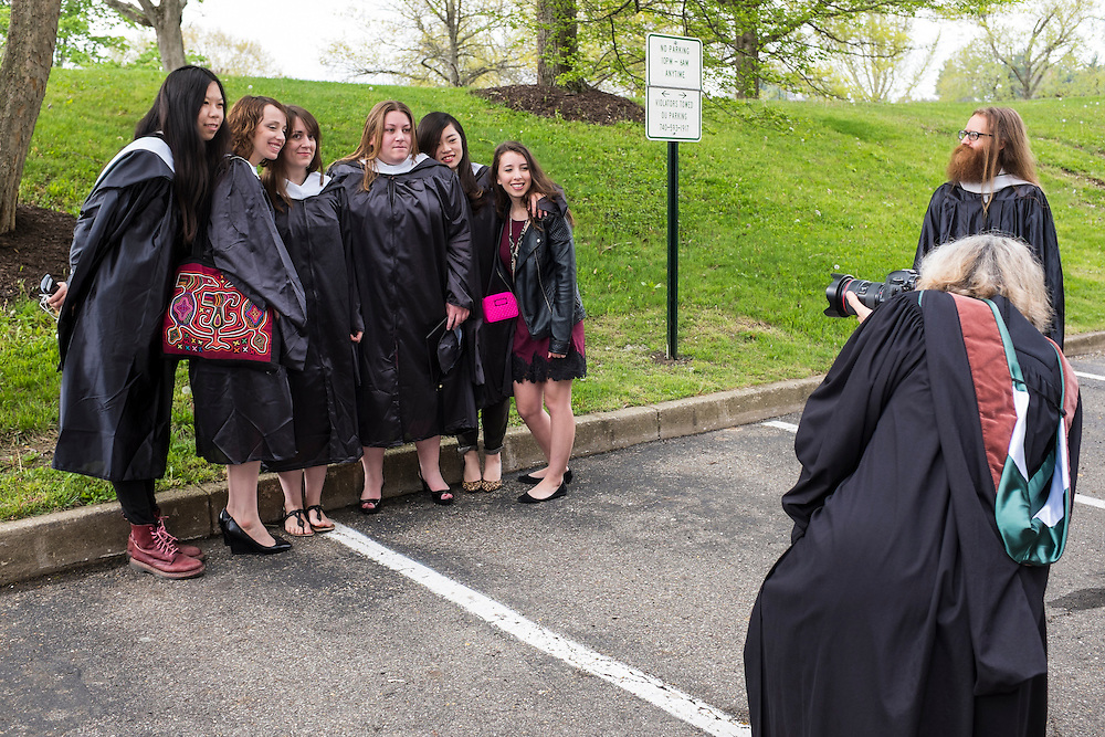 School of Visual Communication graduate students pose for a group photo while Professor Julie Elman works to find the best angle before the start of Graduate Commencement on Friday, May 2, 2015.  Photo by Ohio University  /  Rob Hardin