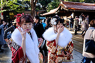 JANUARY 09: Japanese women who celebrate turning 20 years old, clad in Japanese kimono, smile at photographers during a coming of age ceremony at Meiji Jingu shrine in Tokyo, on Coming of Age Day national holiday, Monday, Jan. 9, 2017. While many festive ceremonies are held in various venues throughout Japan, The day is marked by those who turned 20 in the past year after April 1 or will be 20 before March 31 this year. 09/01/2017-Tokyo, JAPAN