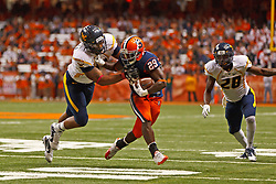 Oct 21, 2011; Syracuse NY, USA;  Syracuse Orange running back Antwon Bailey (29) rushes past West Virginia Mountaineers defensive back Pat Miller (left) during the third quarter at the Carrier Dome.  Syracuse defeated West Virginia 49-23. Mandatory Credit: Jason O. Watson-US PRESSWIRE
