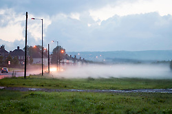 By Friday evening the rain had stopped falling and an eerie ground mist starts to rise from the rain drenched grass and trees drifting out on the Ecclesfield Road Sheffield...6 July 2012.Image © Paul David Drabble