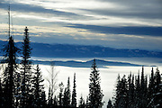 USA, Idaho, Valley County, View of Fog Covered Long Valley from Slopes of West Mountain