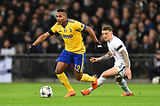 Alex Sandro (12) of Juventus on the attack during the Champions League match between Tottenham Hotspur and Juventus FC at Wembley Stadium, London, England on 7 March 2018. Picture by Graham Hunt.
