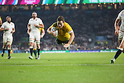 Australia's fly half Bernard Foley scoring Australia's second try to take the score 17 3 during the Rugby World Cup Pool A match between England and Australia at Twickenham, Richmond, United Kingdom on 3 October 2015. Photo by Matthew Redman.
