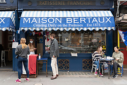 © Licensed to London News Pictures. 04/07/2020. London, UK. Maison Bertaux patisserie reopens to customers as restaurants and bars reopen after a relaxing of rules during the Covid-19 pandemic. Photo credit: Ray Tang/LNP
