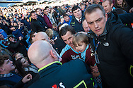 Joey Barton of Burnley is escorted through crowds of fans with his daughter following his sides win at the Sky Bet Championship match at Turf Moor, Burnley<br /> Picture by Matt Wilkinson/Focus Images Ltd 07814 960751<br /> 02/05/2016
