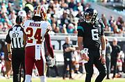 Dec 16, 2018; Jacksonville, FL, USA; Washington Redskins cornerback Josh Norman (24) has a verbal exchange with Jacksonville Jaguars quarterback Cody Kessler (6) during an NFL game at TIAA Bank Field. The Redskins beat the Jaguars 16-13. (Steve Jacobson/Image of Sport)