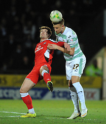 Yeovil Town's Byron Webster challenges for the high ball with Walsall's Tom Bradshaw  - Photo mandatory by-line: Harry Trump/JMP - Mobile: 07966 386802 - 03/03/15 - SPORT - Football - Sky Bet League One - Yeovil v Walsall - Huish Park, Yeovil, England.