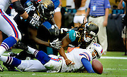 Buffalo Bills quarterback EJ Manuel (3) fumbles the ball after he is tackled by Jacksonville Jaguars free safety Winston Guy (22) during the second half of an NFL football game, Sunday, Dec. 15, 2013, in Jacksonville, Fla. The Bills beat the Jaguars 27-20. (AP Photo/Stephen Morton)