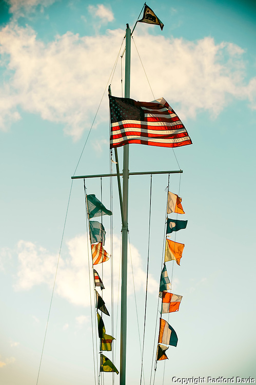 Ship masts and flags at sunset, marina, Monterey, California