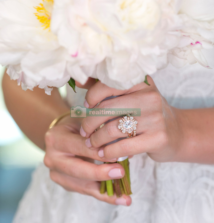 """EXCLUSIVE: Over 14 million American couples are expected to make or receive marriage proposals this Valentine's day. With rings generating the most search traffic during the first seven days of February. In 2019, American consumers will spend over $4.5 billion on jewelry for Valentine's Day. In case you hadn't noticed from the ambush of women sharing Instagram images of their engagement rings, or Pinterest dream engagement virtual vision boards, the British Royal Family is making a huge impact on engagement ring trends. This Valentine's Day an unprecedented number of brides-to-be are seeking heritage-inspired design known in the jewelry industry as the """"Ballerina"""" or """"Cluster"""" ring. The style, worn by The Duchess of Cambridge, Kate Middleton, features a center stone surrounded by a cluster halo of diamonds for an heirloom look associated with Royalty and impecable Style. The Duchess of Sussex, Meghan Markle, is also influencing the mixed metal trend with her three stone ring featuring a yellow gold band and white gold setting, another gorgeous vintage design detail. """"The Royal family has had a huge influence on the type of engagement rings people are seeking. More and more Americans are attracted to the idea of having a ring that doesn't look like everyone else's, that has a heritage feel,"""" explained Michelle Day founder of The Michelle Day Heritage, a line of Engagement and Special Occasion rings """"Couples are coming in requesting we make them a ring that will become their family heirloom, a ring to last for generations. They are seeking a unique design that feels to have a legacy to it and vintage proportions. Our Duchess ring, which features the exact width and depth proportions as the one worn by Kate, is also our most requested."""" As sales of the Ballerina and Cluster ring begin to spike, sales of the once ubiquitous six and four-pronged diamond solitaire and the once coveted pave halo, previously favored by Hollywood celebrities over th"""