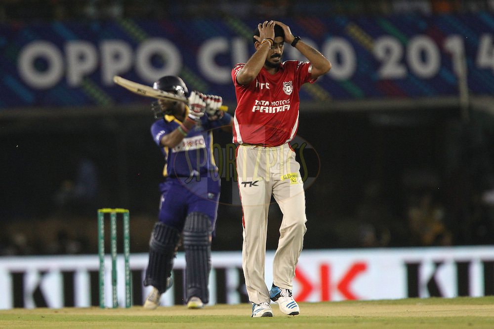 Anureet SINGH of the Kings XI Punjab reacts after a delivery during match 5 of the Oppo Champions League Twenty20 between the Kings XI Punjab and the Barbados Tridents held at the Punjab Cricket Association Stadium, Mohali, India on the 20th September 2014<br /> <br /> Photo by:  Ron Gaunt / Sportzpics/ CLT20<br /> <br /> <br /> Image use is subject to the terms and conditions as laid out by the BCCI/ CLT20.  The terms and conditions can be downloaded here:<br /> <br /> http://sportzpics.photoshelter.com/gallery/CLT20-Image-Terms-and-Conditions-2014/G0000IfNJn535VPU/C0000QhhKadWcjYs