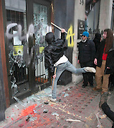 26.MARCH.2011. LONDON<br /> <br /> PROTESTORS AND POLICE CLASH AS RIOTERS SMASH AND THROW PAINT ON THE WINDOWS OF LONDON SHOPS AND STORES AS THE ANTI-CUTS PROTEST AGAINST THE BRITISH GOVERNMENT TURNS UGLY.<br /> <br /> BYLINE: EDBIMAGEARCHIVE.COM<br /> <br /> *THIS IMAGE IS STRICTLY FOR UK NEWSPAPERS AND MAGAZINES ONLY*<br /> *FOR WORLD WIDE SALES AND WEB USE PLEASE CONTACT EDBIMAGEARCHIVE - 0208 954 5968*