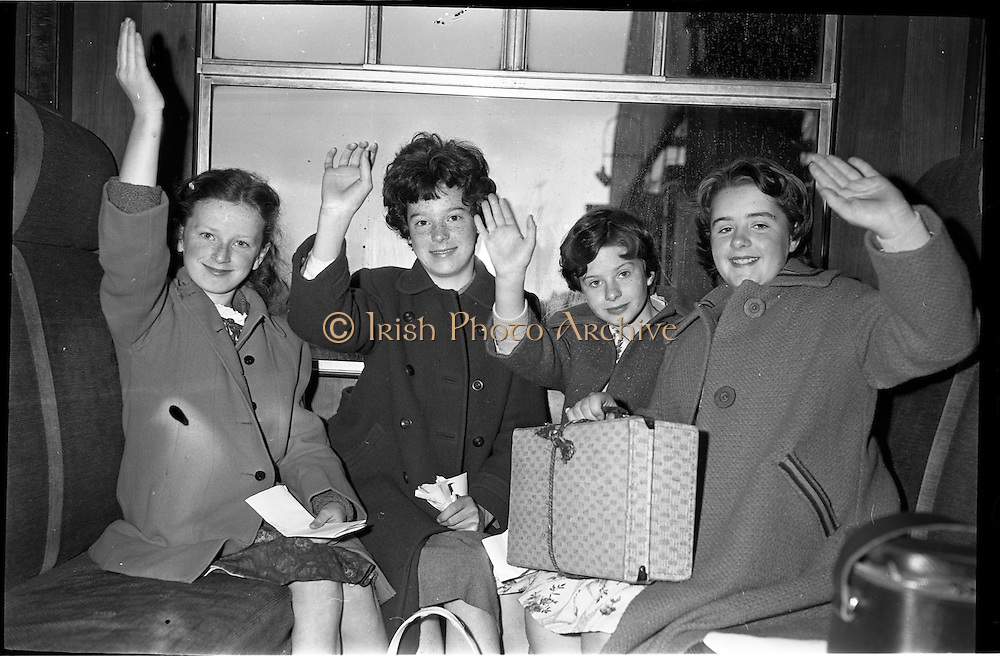 11/09/1962<br /> 09/11/1962<br /> 11 September 1962<br /> Gael Linn Scholarship winners leave for the Gaeltacht.<br /> Over 30 scholarship winners left Westland Row Station (Pearse Station), Dublin to spend three months in the Gaeltacht. Image shows some of the children waving goodbye to their relatives before the train departed.