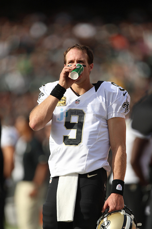 New Orleans Saints quarterback Drew Brees (9) drinks a cup of Gatorade against the Oakland Raiders during an NFL game on Sunday, Nov. 18, 2012 at the Oakland Coliseum in Oakland, Ca. (photo by Jed Jacobsohn)