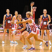 Anna Thompson passing the ball for the Tactix with pressure from defender Renae Hallinan of the Thunderbirds during the ANZ Championship Netball game between the Mainland Tactix v Adelaide Thunderbirds at Horncastle Arena in Christchurch. 20th April 2015 Photo: Joseph Johnson/www.photosport.co.nz