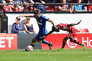 AFC Wimbledon midfielder Chris Whelpdale (11) and Walsall FC defender Rico Henry (3) tussle during the EFL Sky Bet League 1 match between Walsall and AFC Wimbledon at the Banks's Stadium, Walsall, England on 6 August 2016. Photo by Stuart Butcher.