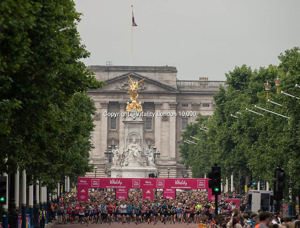 Runners just after the start with Buckingham Palace in the background during the Vitality London 10,000, Monday 29th May 2017.<br /> <br /> Photo: Bob Martin for The Vitality London 10,000<br /> For further information: media@londonmarathonevents.co.uk
