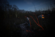 A migant search for some privacy during a phone call in a flooded area of the Grande Synthe camp, France. FEDERICO SCOPPA/CAPTA