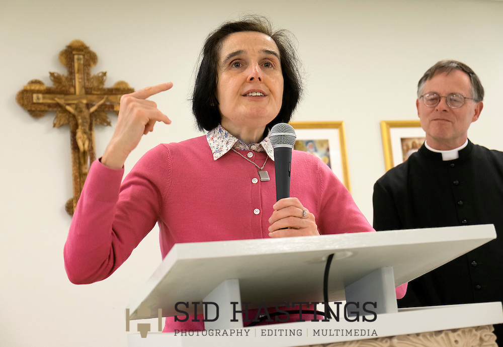 30 APRIL 2016 -- WENTZVILLE, Mo. -- Gianna Emanuela Molla (left), daughter of St. Gianna Beretta Molla, delivers remarks during a reception following Mass at St. Gianna Catholic Church in Wentzville, Mo. Saturday, April 30, 2016. The event honored the visit of Molla and marked the 10th anniversary of the founding of St. Gianna Parish. Joining Molla is Father Timothy Elliott, pastor at St. Gianna. Photo © copyright 2016 Sid Hastings.