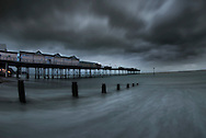 Stormy skies over Teignmouth pier, Teignmouth, South Devon, England.