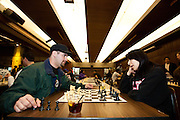 Edgar Lopez, Senior Chemical Forensic Science, and Maritsa Lopez, Senior Justice Studies, play chess at the Human Rights Lecture in the Barrett Ballroom at the Student Union, San Jose State University, San Jose, Calif., on March 21, 2012.  Photo by Stan Olszewski/Spartan Daily