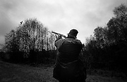 A hunter points and shoot a duck in the countryside of the Danish island Funen on sunday  17. November 2002.  Photo: Erik Luntang
