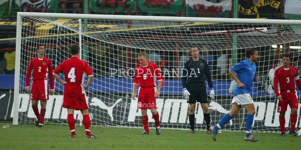 MILAN, ITALY - Saturday, September 6, 2003: Wales' (l-r) Mark Delaney, Jason Koumas, Mark Pembridge and Paul Jones dejected after Italy second goal during the Euro 2004 qualifying match at the San Siro Stadium. (Pic by David Rawcliffe/Propaganda)