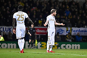 Leeds United midfielder Eunan O'Kane (14) reacts after having his shorts pulled down by Burton Albion goalkeeper Stephen Bywater (1) during the EFL Sky Bet Championship match between Burton Albion and Leeds United at the Pirelli Stadium, Burton upon Trent, England on 26 December 2017. Photo by Richard Holmes.