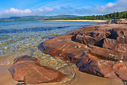 Rock and sandy beach at Prisoner's Cove on Lake Superior<br />