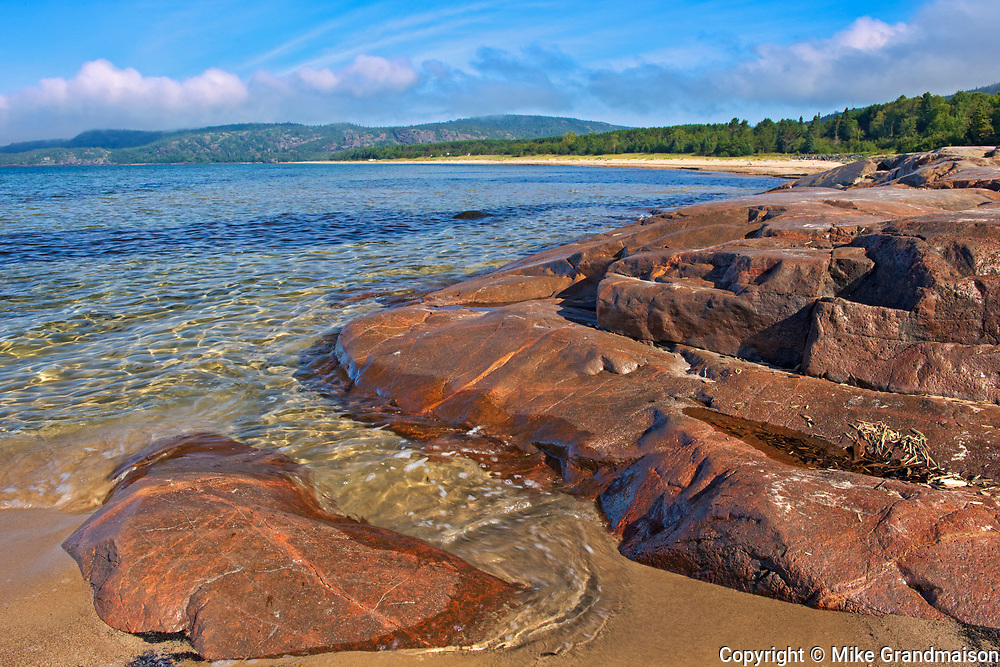 Rock and sandy beach at Prisoner's Cove on Lake Superior<br />Neys Provincial Park<br />Ontario<br />Canada