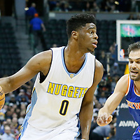 08 March 2016: Denver Nuggets guard Emmanuel Mudiay (0) drives past New York Knicks guard Jose Calderon (3) on a screen set by Denver Nuggets forward Kenneth Faried (35) during the Denver Nuggets 110-94 victory over the New York Knicks, at the Pepsi Center, Denver, Colorado, USA.