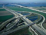 Nederland, Noord-Brabant, Klaverpolder, 17-10-2003; luchtfoto (25% toeslag); knooppunt Klaverpolder (half klaverblad), aan de horizon het Hollandsch Diep met de Moerdijkbruggen, rechts de spoorlijn naar Breda en Roosendaal; aanleg HSL (hogesnelheidslijn); verkeer en vervoer, transport, infrastructuur, bouwen, spoor, rail, planologie ruimtelijke ordening, landschap; DEEL VAN EEN SERIE OVER  INFRASTRUCTUUR (zie ook andere (lucht)foto's)..Foto Siebe Swart