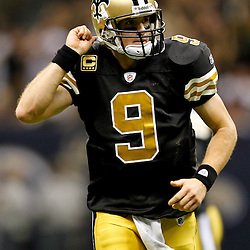 September 25, 2011; New Orleans, LA, USA; New Orleans Saints quarterback Drew Brees (9) celebrates following a touchdown pass against the Houston Texans during the fourth quarter at the Louisiana Superdome. The Saints defeated the Texans 40-33. Mandatory Credit: Derick E. Hingle