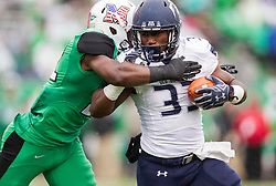 Oct 3, 2015; Huntington, WV, USA; Old Dominion Monarchs running back Ray Lawry is tackled by a Marshall Thundering Herd defender during the first quarter  at Joan C. Edwards Stadium. Mandatory Credit: Ben Queen-USA TODAY Sports