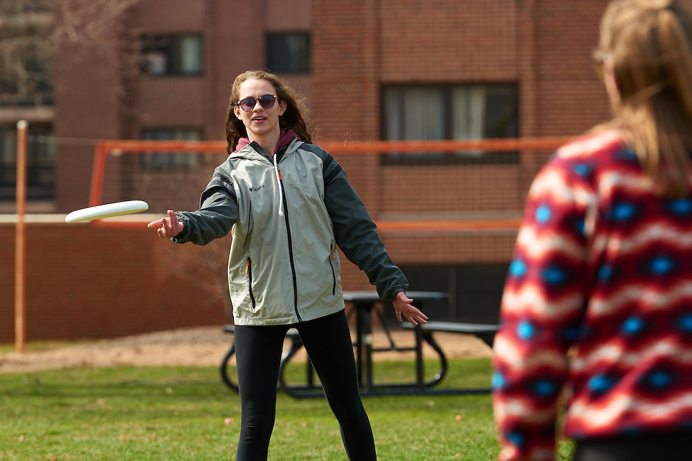 Frisbe; Drake Field; People; Woman Women; Location; Outside; Student Students; Spring; April; Time/Weather; cloudy; Type of Photography; Candid; UWL UW-L UW-La Crosse University of Wisconsin-La Crosse