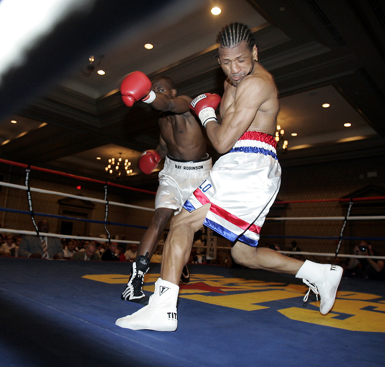 Bronx resident Harrison Cuello, right, fights Ray Robinson of Philadelphia, PA on the undercard of a Star Boxing event at the Rye Town Hilton ballroom July 16, 2009.  Robinson won the fight by unanimous decision.  ( Mike Roy / The Journal News )