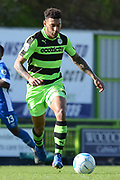 Forest Green Rovers midfielder Kaiyne Woolery (14) on the attack 0-1 during the Vanarama National League match between Forest Green Rovers and North Ferriby United at the New Lawn, Forest Green, United Kingdom on 1 April 2017. Photo by Alan Franklin.