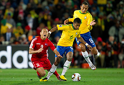 Football - soccer: FIFA World Cup South Africa 2010, Brazil (BRA) - Korea DPR (PRK), Korea's Jong Tae Se vs Brazil's Michel Bastos during the 2010 FIFA World Cup South Africa Group G match between Brazil and North Korea at Ellis Park Stadium on June 15, 2010 in Johannesburg, South Africa.