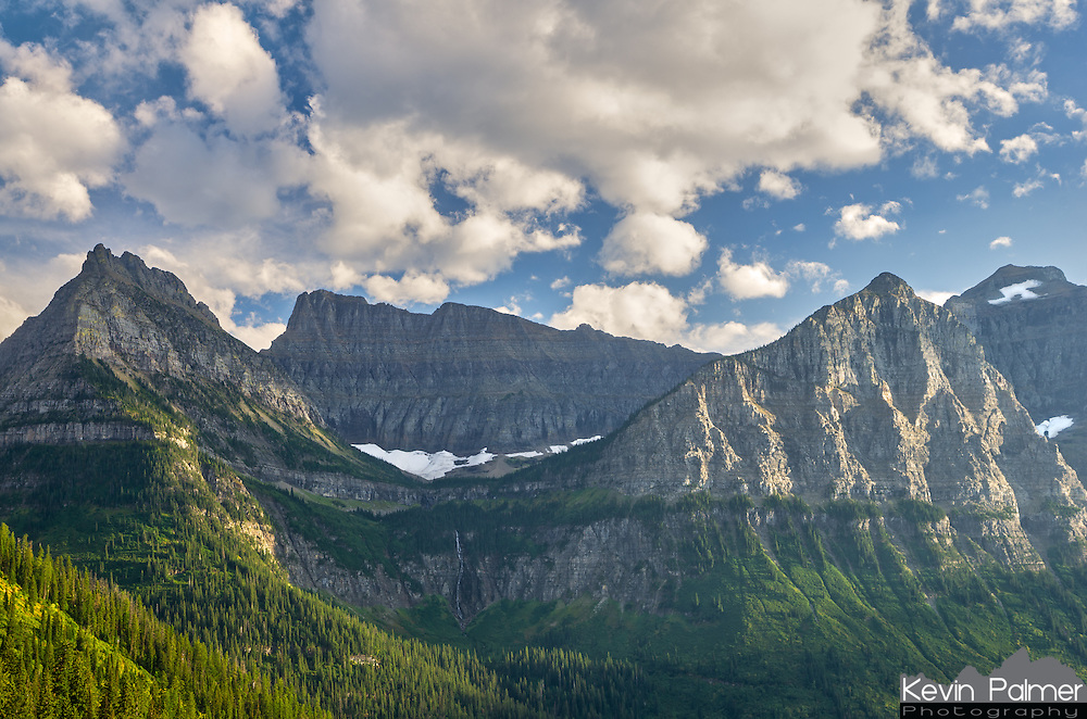 This is one of many amazing views you'll see when driving Going to the Sun Road in Glacier National Park.. If you look closely under the glacier you can see Bird Woman Falls which drops 560 feet. It has a much higher flow in the spring and is a lot harder to see in the fall.