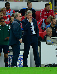 England Manager, Roy Hodgson confers with England assistant manager, Ray Lewington- Photo mandatory by-line: Joe Meredith/JMP - Mobile: 07966 386802 - 3/09/14 - SPORT - FOOTBALL - London - Wembley Stadium - England v Norway - International Friendly