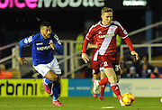 Adam Forshaw gets away from David Davis during the Sky Bet Championship match between Birmingham City and Middlesbrough at St Andrews, Birmingham, England on 18 February 2015. Photo by Simon Kimber.